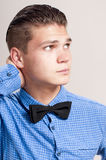 Profile of gallant man. Profile of gallant man in the blue shirt with black bow tie Royalty Free Stock Images