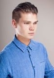 Profile of  gallant man in the blue shirt. Profile of  gallant man in the blue shirt, over gray background Royalty Free Stock Photo