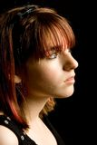 Profile of a Girl. A low-key profile shot of a teenager stock image
