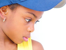 Profile of girl in blue hat. Profile of young girl wearing a blue baseball cap Royalty Free Stock Photos