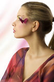 Profile girl with butterfly royalty free stock photo