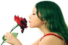 Profile of girl child with flower. Stock Image