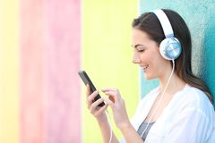 Profile of a girl choosing songs listening to music royalty free stock photo