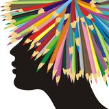 Profile of a girl and crayons Stock Photo