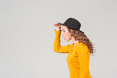The profile of girl in hat Stock Photos