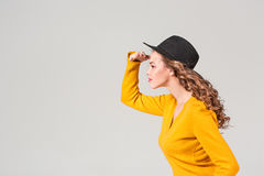 The profile of girl in hat Royalty Free Stock Images