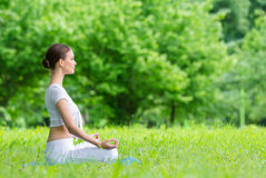 Profile of girl in lotus position zen gesturing Stock Photos