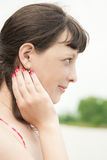 Profile of a girl. Portrait in profile of a young woman with a red manicure Royalty Free Stock Images