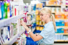 Profile of girl at the shop choosing cosmetics Stock Photography