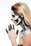 Profile of girl with terrifying halloween makeup. Over white background Stock Image