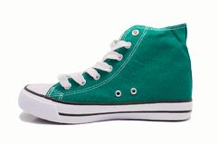 Profile of a green sneaker Stock Images