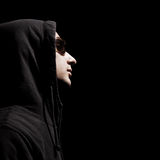 Profile of handsome man in hood. And sunglasses Stock Images