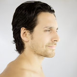 Profile of a handsome man smiling Royalty Free Stock Photography