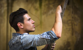 Profile of handsome young man in abandoned building Royalty Free Stock Photography