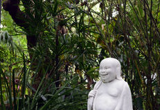 Profile of a Happy Buddha in Asian garden. Royalty Free Stock Images