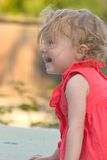 Profile of happy little girl laughing stock photo