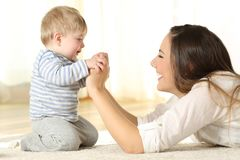 Profile of a mother and her kid son holding hands Stock Photography