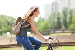 Profile of a happy woman on a bicycle royalty free stock image