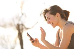 Profile of a happy woman having a video call stock photography