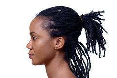 Profile headshot of dark-skinned woman. Against white background royalty free stock photography