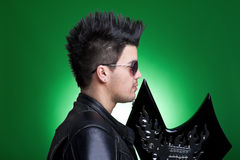Profile of a heavy metal guitarist Royalty Free Stock Photo