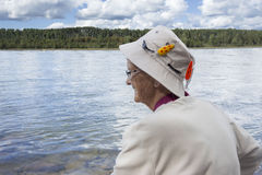 Profile image of a senior lady wearing a fishing hat. Royalty Free Stock Photo