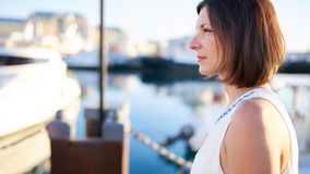 Profile image of sophisticated mature caucasian woman at the marina Royalty Free Stock Photos