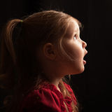 Profile of an infant in awe Royalty Free Stock Image