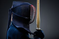Profile of kendo fighter with shinai. Japanese martial art of sword fighting Stock Photography