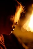 Profile of kidby fire. Profile of kid standing next to bonfire Royalty Free Stock Photography