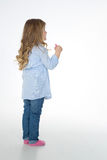 Profile of little child standing Stock Image
