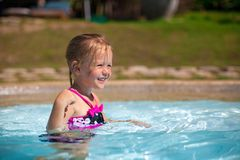 Profile of a little girl enjoy in the swimming Stock Image