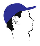 Profile of a man in a blue baseball cap Stock Photography