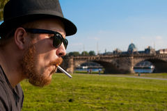 Profile man with a cigarette Royalty Free Stock Photos