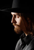 Profile of man in hat. Low key stock photography