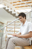 Profile of Man with Laptop on Stairs Royalty Free Stock Photo