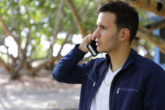 Profile of a man talking on the phone Royalty Free Stock Photos