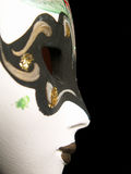 Profile of mask of a woman Stock Photo