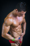 Profile of muscular bodybuilder relaxed in Stock Photos
