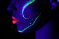 Profile neon makeup with black light Stock Photo