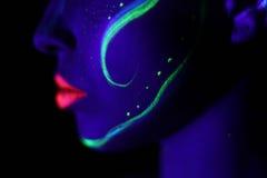 Profile neon makeup with black light Stock Photo