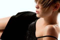 Profile ofl young woman in black dress Stock Image