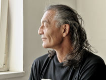 Profile of the older man. Profile portrait of the older man with a long hair royalty free stock photography