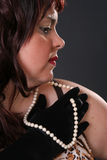 Profile with pearls Royalty Free Stock Photo