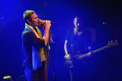 A profile of a performing rock singer. The concert of Okean Elzy, a Ukrainian rock band played in Helsinki. Svyatoslav Vakarchuk performing a song wearing a Royalty Free Stock Photo