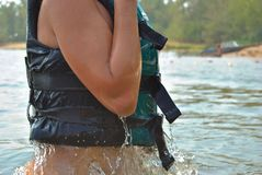 Profile of person in life jacket stock photo