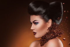 Profile photo of sexy adult woman with professional make up and. Hairstyle with coffee beans in studio Stock Photos