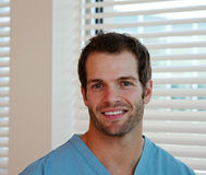 Profile of physician in scrubs. Profile of physician wearing scrubs Royalty Free Stock Photography
