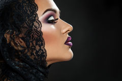 Profile picture of sexy woman on black blackground Stock Image