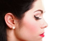 Profile, pin-up girl make-up and vintage hairstyle Royalty Free Stock Images